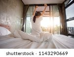the back of the girl woke up in ... | Shutterstock . vector #1143290669