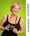 Woman With Old Camera Isolated...
