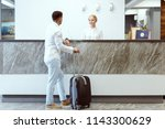 man at hotel reception. | Shutterstock . vector #1143300629