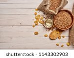 cereals in a plate flakes on a ... | Shutterstock . vector #1143302903