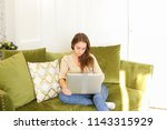 girl with laptop sitting on...   Shutterstock . vector #1143315929