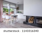 modern fireplace and wood in a...   Shutterstock . vector #1143316340