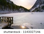 Panticosa snow frozen lake ice in Huesca Pyrenees of Spain