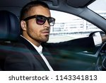 handsome businessman is sitting ...   Shutterstock . vector #1143341813