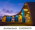 Colorfull bus station waiting area during sunset - stock photo