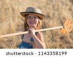 smiling child with butterfly net   Shutterstock . vector #1143358199