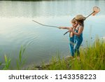 two children with a butterfly...   Shutterstock . vector #1143358223