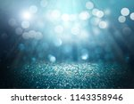 blue glitter lights background.... | Shutterstock . vector #1143358946