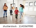excited family carrying boxes... | Shutterstock . vector #1143369980