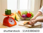 the housewife is cutting... | Shutterstock . vector #1143380603
