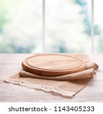 empty textured wooden pizza... | Shutterstock . vector #1143405233