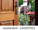 half opened door into the... | Shutterstock . vector #1143427013