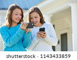 sister twins having fun with... | Shutterstock . vector #1143433859
