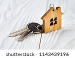 house keys with house shaped... | Shutterstock . vector #1143439196