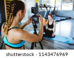 athlete blogger making a video | Shutterstock . vector #1143476969
