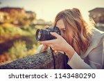 photographer girl with... | Shutterstock . vector #1143480290