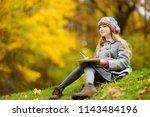 cute little girl sketching...   Shutterstock . vector #1143484196