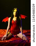girl sexy demon with wings ... | Shutterstock . vector #1143488339