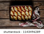 baked cheese and spinach... | Shutterstock . vector #1143496289