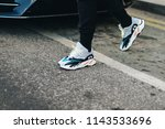 Small photo of LONDON, United Kingdom- February 18 2018: Man on the street during the London Fashion Week wearing ADIDAS OG YEEZY WAVE RUNNER 700