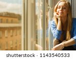 happy woman with long blonde...   Shutterstock . vector #1143540533