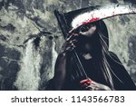 witch licking blood on reaper.... | Shutterstock . vector #1143566783