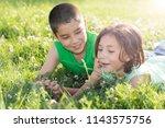 cute teenage girl and boy lying ... | Shutterstock . vector #1143575756