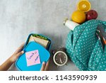 mother preparing for her... | Shutterstock . vector #1143590939