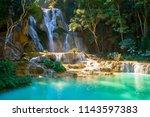kuang si waterfalls in luang... | Shutterstock . vector #1143597383
