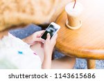 woman using mobile phone in... | Shutterstock . vector #1143615686