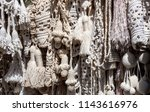 Fringe, cords, tassels for curtains and other interior accessories. Woven and knitted texture, white color of different shades, macrame. Street stall at flea market. Israel