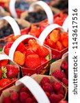 punnets of strawberries ... | Shutterstock . vector #1143617516