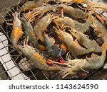 prawns grill on hot charcoals...   Shutterstock . vector #1143624590