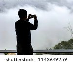 Silhouette Of The Man Use Cell...