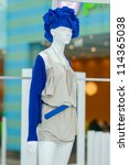 Color art dresses and suits on mannequins in mall - stock photo