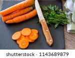 chopping healthy carrots on... | Shutterstock . vector #1143689879