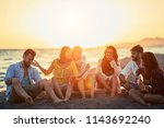 group of happy friends having a ... | Shutterstock . vector #1143692240
