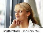 smile blond woman with hand   Shutterstock . vector #1143707753