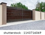automatic gates with a forged... | Shutterstock . vector #1143716069