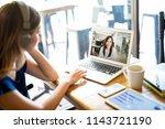 woman wearing headphones and... | Shutterstock . vector #1143721190