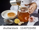 man pouring a brew of sweetened ... | Shutterstock . vector #1143722450