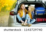 two adorable girls sitting in a ... | Shutterstock . vector #1143729740