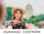 beautiful woman in black dress... | Shutterstock . vector #1143740396