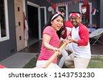 asian people doing tug of war... | Shutterstock . vector #1143753230
