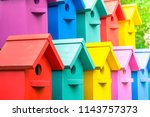 A Lot Of Colorful Birdhouses....