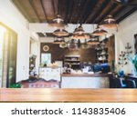 brown wooden table at cafe... | Shutterstock . vector #1143835406