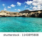 Manolis Bay, Akamas Peninsula, Cyprus. Taken from the middle of the bay, looking in towards the rocks. - stock photo