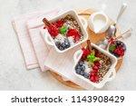 healhty vegan breakfast bowl... | Shutterstock . vector #1143908429