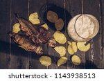 lager beer and snacks on table. ... | Shutterstock . vector #1143938513