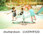 Happy Asian Kids Playing Carousel - Fine Art prints